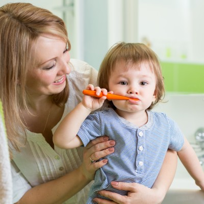 Mother and son brushing teeth learning routines