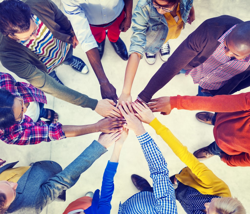 Counselling supporters all hands in a circle