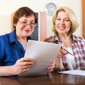Two women reading over services available