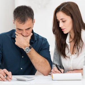 Two people looking over finances