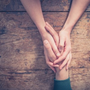 counselling support, two hands holding one