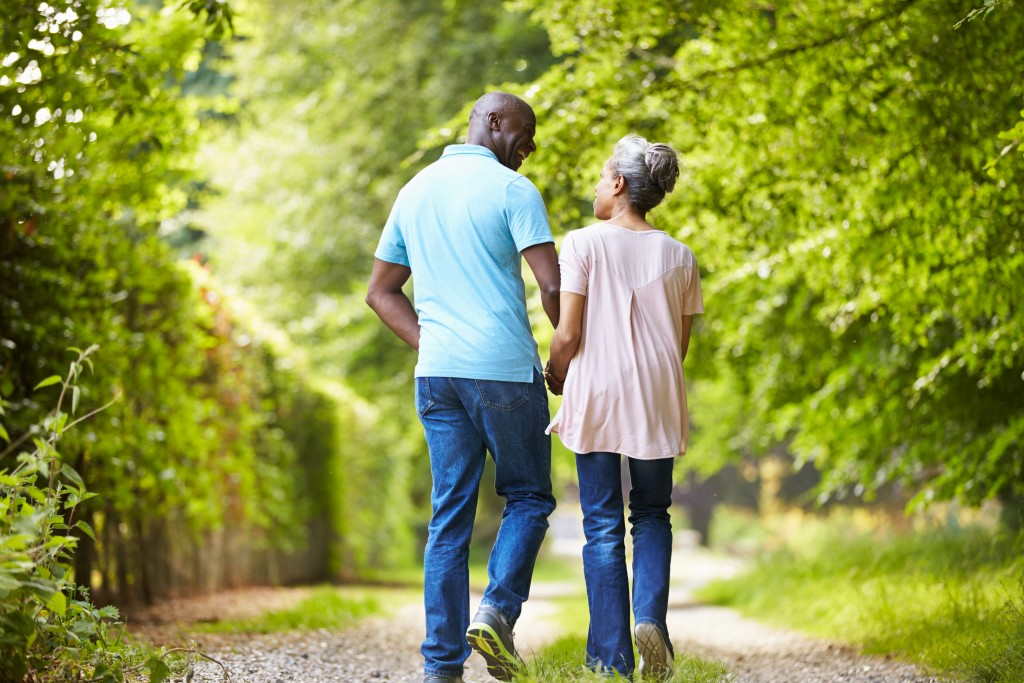 Couple walks down trail together